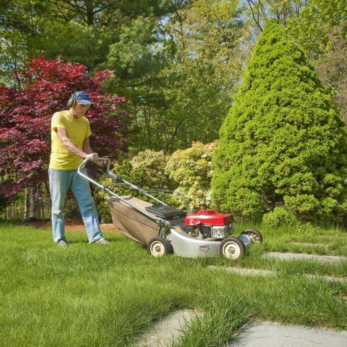 man using a lawn mower