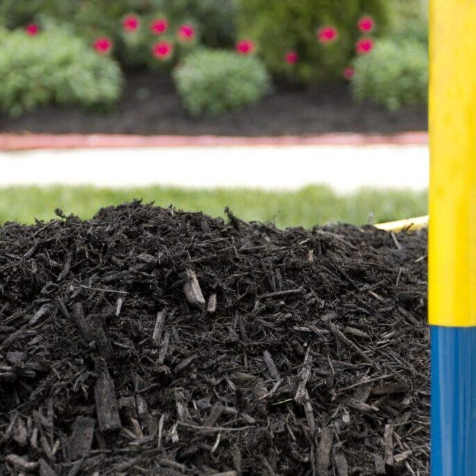 a fertilizer on a garden